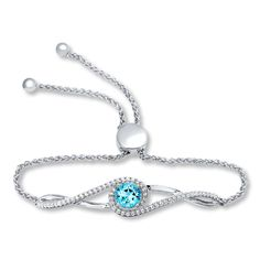 This stunning sterling silver bolo bracelet is highlighted in tendrils of lab-created white sapphires and a twinkling round blue topaz. The clasp allows for an adjustable fit up to 9 inches in length.Topaz is  commonly subject to enhancement processes or treatments such heating, irradiation and diffusion, which may not be permanent and may require special care.  Gently clean by rinsing in warm water and drying with a soft cloth, and avoid chemicals, strong light, heat and ul...