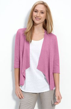 I have several Eileen Fisher sweaters in several bright colors...sweater sets go with everything