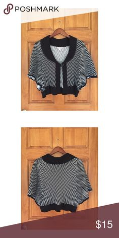 LUX sweater cape LUX brand black and white cape style sweater. Has one large button in front. Size SMALL but has a loose cape style and can fit a size medium. Lux Sweaters Shrugs & Ponchos