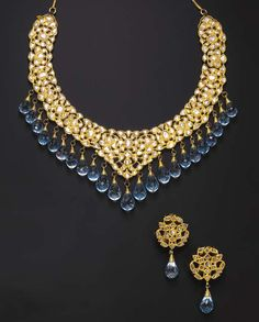 openwork bib necklace & earring suite set w/ table-cut diamonds within foiled surrounds, graduated briolette-cut blue topaz fringe which also reverses to reveal enamelled red, green and blue floral motifs Enamel Jewelry, Gemstone Jewelry, Antique Jewelry, Antique Gold, Gold Jewelry, Vintage Jewelry, India Jewelry, Jewelry Sets, Fine Jewelry