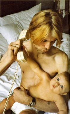 A shirtless Kurt Cobain of Nirvana with Frances Bean as a babe in armsahhhh!