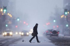 WINTER STORM HITS THE NE U.S. A MAN CROSSES BROAD STREET DURING A WINTER SNOWSTORM ON 1/21/14 IN PHILADELPHIA. A SWIRLING STORM WITH THE POTENTIAL FOR MORE THAN A FOOT OF SNOW CLOBBERED THE MID-ATLANTIC AND URBAN NE ON 1/21/14