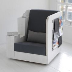 A cozy seating nook by Studio Tilt for bookworms who want the written word at their fingertips.