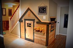 This playhouse was built under a basement stairs. Great place for the kids to read a book, play or watch a movie.