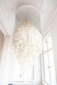 Amazing large capiz shell chandelier in traditional white space. Capiz Chandelier, White Chandelier, Modern Chandelier, Seashell Chandelier, Chandelier Crystals, Crystal Chandeliers, Pendant Chandelier, Shell Pendant, Pendant Lights