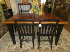 """Broyhill pub height table with four (4) bar height bar stools. Done in the classic Broyhill black and tan. Measures 48 x 48 with (2)18"""" leaves. Arrived: Wednesday October 5th, 2016"""