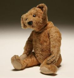 """Four teddy bears; smal early jointed cinnamon bear, small jointed Steiff bear on all fours with collar and bell, small jointed Steiff bear, vintage Steiff Zotti bear with pug face. Tallest 9 1/2""""H. Surface wear, repair to Zotti paw, one Steiff tag missing, Zotti has button and partial cloth tag."""