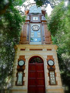 """Lost in a Forest all alone! Clock & Meteorological Station """"La Torre del Reloj"""" (1883) in the Ca l'Arnús Public Garden in Badalona Barcelona Spain"""