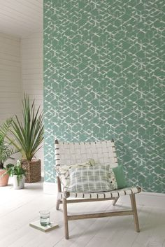 Emerald green wallpaper that has been inspired by Japanese trellis patterns.