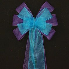 """This turquoise and purple sheer wedding bow is created with a 2-2.5"""" sheer ribbons with wire edge. This bow is the perfect bow to hang on pews in a church or to use a chair bows at the receptions. Bow"""