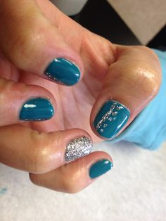 Dark teal with silver glitter lines and poke a dots designs and silver glitter accent nails  Oasis Salon and Spa Mill Hall Pa (570)726-6565