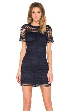 Lucy Paris Embroidered Overlay Dress in Navy Shell: 100% poly Lining: 95% poly , 5% spandex Dry clean only Partially lined Back hidden zipper closure