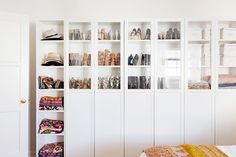 """Freestanding IKEA storage in her closet-light bedroom. """"The IKEA wall unit was a godsend because it's slim, clean, and totally functional, via @MyDomaine"""