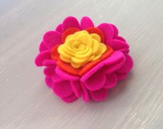This full hair clip is a larger sized flower with multiple layers and much texture. It is a hand-crafted one-of-a-kind piece made with the highest