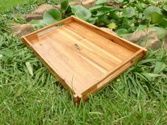 Vintage pecan serving tray with an inlay of reclaimed wood in the center and corner lap joints