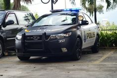 Kia Forte as a police car in Malaysia dressed up in police gear.