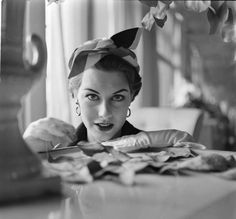 """Swedish-born actress and model Gita Hall (b. 1933), also known as """"Nancy Berg,"""" wearing a design by Jacques Fath, 1952."""
