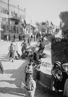Children at Omar Ibn Khattab square playing inside the Jaffa gate Jerusalem 1900