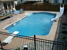 swimming pools winnipeg, inground pools winnipeg, pools winnipeg, Frost proof ceramic tile installed on a membrane over concrete makes for an amazing patio on this 18 x 36 Olympian Pool. This swimming pool is ready for use.