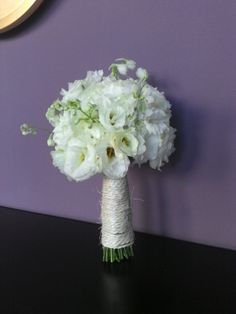White lisianthus and delphinium bridal bouquet. Wrap with a natural ribbon