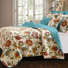 Brimming with the appeal of a lavish garden, this reversible cotton quilt set showcases a charming and colorful floral motif.   Pro...
