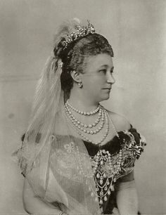 Kaiserin Augusta Viktoria of Prussia in courtgown. Late 1890s.