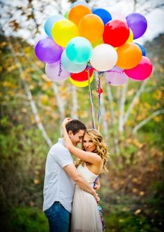 Brighten up your engagement photos with colorful balloons.