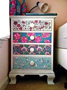 Cover an ugly dorm dresser with removable scrapbook paper.  Southern By the Grace of God