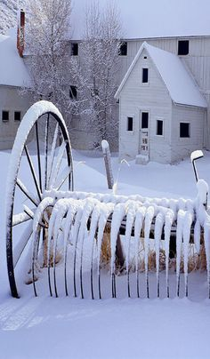 White Barn With Snow On Old Hay Rake.