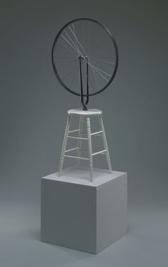 Bicycle Wheel Marcel Duchamp 1964 (replica of 1913 original) Medium: Wheel, painted wood Dimensions: Diameter: 25 1/2inches (64.8cm) Base height: 23 1/2 inches (59.7 cm)