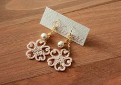 Sweet design on these tatted earrings.