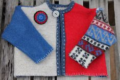 Children's cardigan made from recycled / upcycled wool sweaters that have been felted, cut apart and restitched into fun wearable art for children.