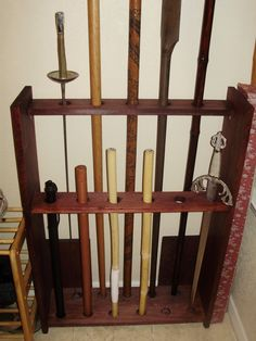 Martial arts gear Another example weapon rack Kung Fu, Wood Projects, Woodworking Projects, Les Gobelins, Historical European Martial Arts, Belt Display, Martial Arts Weapons, Weapon Storage, Art Studio Design