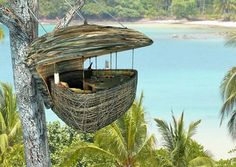 The Dining Pod at Soneva Kiri - Koh Kood, Thailand - picture-perfect scenery as you are winched 16 feet into the air above the shoreline in the dining pod. This brilliant concept will seat up to four people who will be served by a flying waiter harnessed to a zip-line. Soooooo awesome!