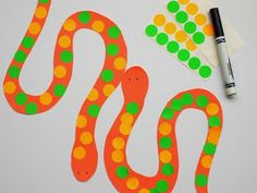 decorate snakes with circle stickers and markers