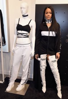 Rihanna poses for photos outside in front of a window display while launching her new Fenty Puma collection at Bergdorf Goodman on Tuesday (September 6) in New York City. The 28-year-old singer is marking the start of New York Fashion Week with her event.