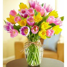 When beautiful tulips are blooming, Spring can't be too far behind! The cheery, colorful tulips in our bouquet are picked fresh, then hand-arranged in a simple clear vase tied with raffia to let their bright beauty shine through. Send a smile today with this timeless favorite. Send #Flowers to #Philadelphia.