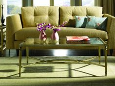 Hammary Furniture Ellipse Rectangular Coffee Table by Hammary Furniture. $210.00. The Hammary Furniture T3001400-00 Ellipse rectangular Coffee table offers Straight tapered legs make up a golden finished metal frame which supports an upper tempered glass top bordered in the golden finished metal frame Pair the Hammary Furniture T3001400-00 Ellipse rectangular Coffee table with the coordinating sofa table and end tables in this collection to outfit the living room i...