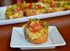 Fried mozzarella and heirloom tomato crostini