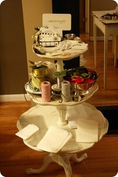 Ceramic bowls /trays w/ stickers & buttons. Easy to grab from, preferably a turning /spinning pedestal.