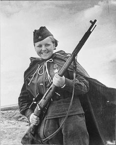 Sniper Maria Kuvshinova smiles at the photographer while clasping her Mosin Nagant sniper rifle. With several dozen confirmed kills of enemy soldiers and officers, Kuvshinova earned the Order of Glory of the USSR, third class. May 1944.