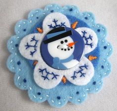 Felt snowman on a snowflake ornament