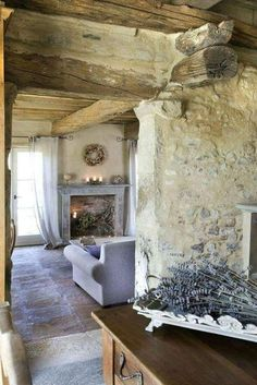 Charming limestone weathered walls and rough hewn beams in French farmhouse living room with French lavender. French Farmhouse Decor Inspiration Ideas will take you on a romantic tour of images capturing this charming decor style. French Farmhouse Decor, French Country Living Room, French Country Cottage, French Country Style, French Decor, French Country Decorating, Country Farmhouse, Cottage Style, Farmhouse Interior
