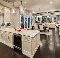love the openness of the space, tray ceilings and the dark flooring.