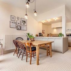Scandinavian inspired white kitchen with  Winckelmans Super White 5cm Hexagon tiles anchor this light and bright kitchen, pendant lighting and framed art add to the charm  in @gewoonthuis kitchen.