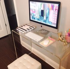 Love the acrylic desk. The gold accessories and minimalist look are so chic
