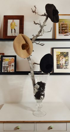 diy hat rack.. I can use my sand and rocks from Italy to weigh it down and... I live in the woods, sticks everywhere!