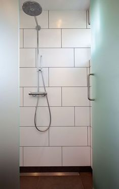 30 x 60 white wall tiles laid in offset pattern with grey grout White Tiles Grey Grout, Large White Tiles, White Tile Shower, White Bathroom Tiles, Laundry In Bathroom, Small Bathroom, Large Tile Shower, Shower Bathroom, Shower Tiles