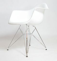 white eames lounge chair. looks great with our wooden table