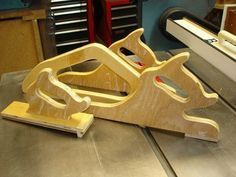 Save your fingers from a table saw n other cutting with these guides: